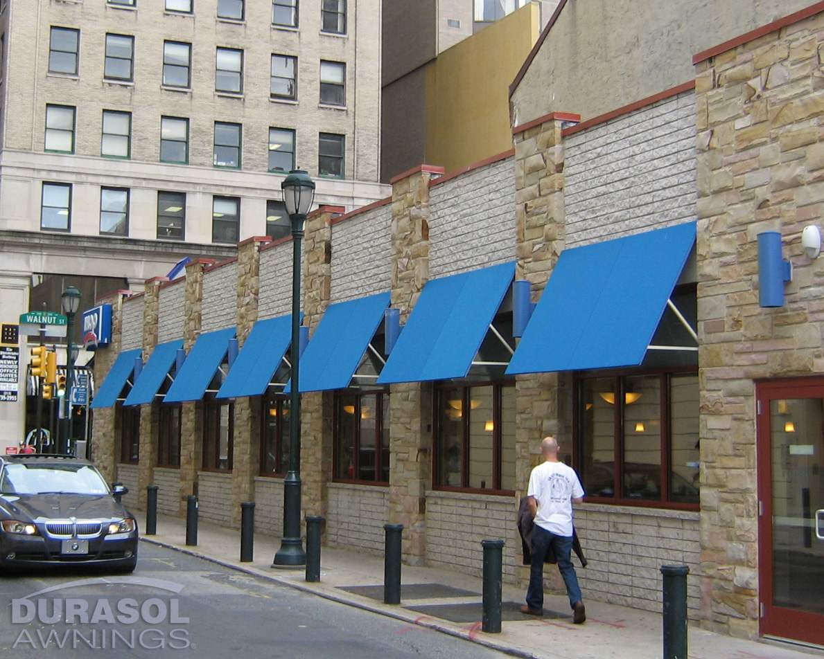 Multiple Blue Store Window Awnings