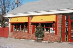 Yellow Store Window Awnings