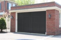 One Dark Green Garage Door